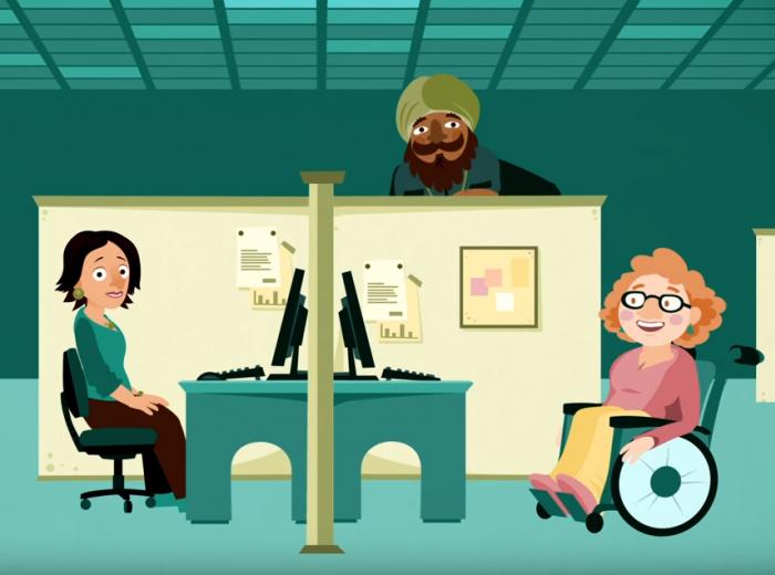 Trois personnes dans un lieu de travail. Une personne est en fauteuil roulant