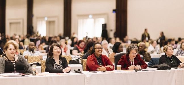 Conference delegates sitting